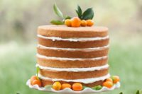 21 a naked wedding cake topped with kumquats for a bold summer wedding