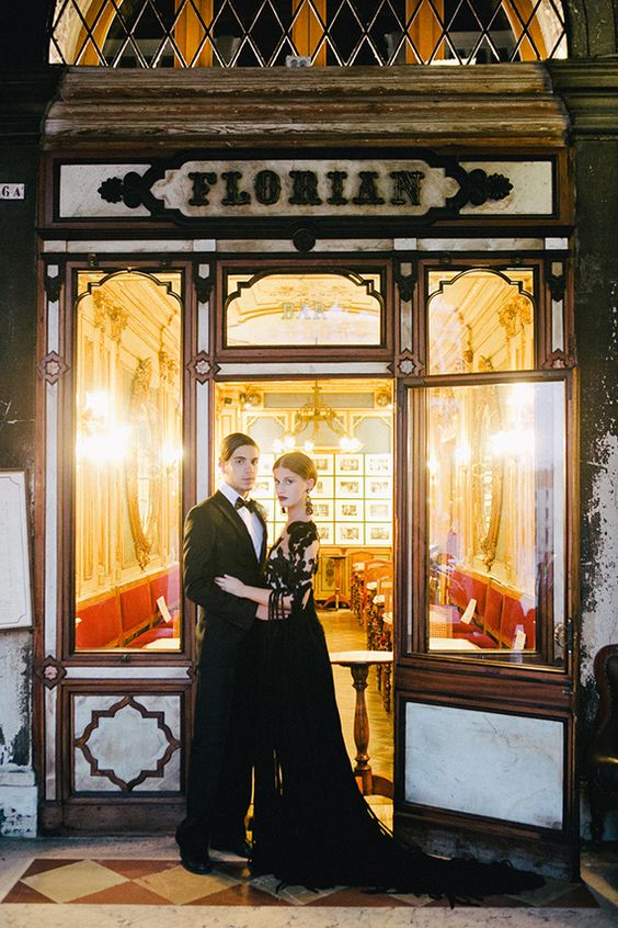 if you are planning a carnival elopement, dress up in dark attire to fit the mysterious look of the city