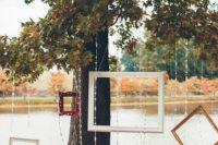 21 lake photo booth with hanging frames and crystals to make it more interesting