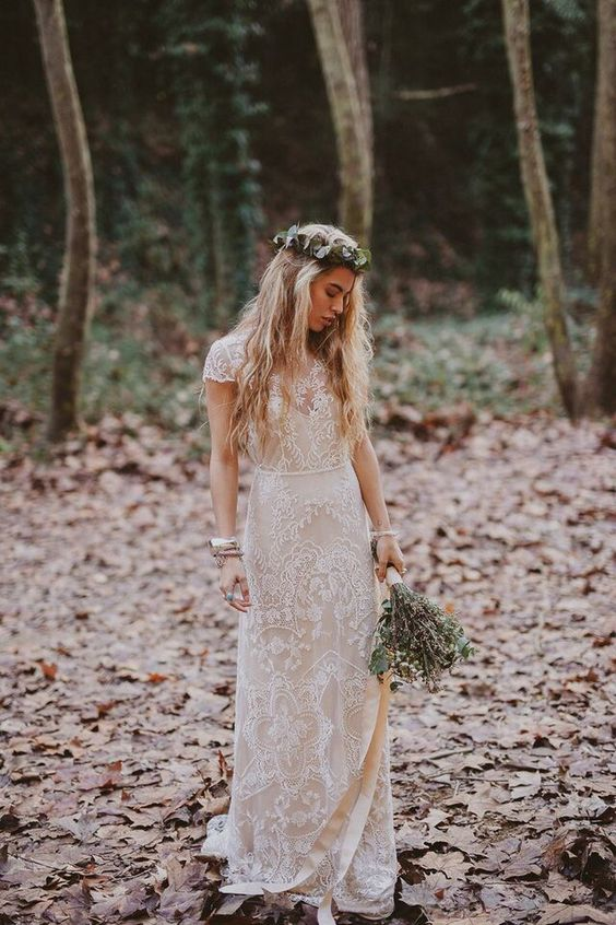 a boho lace wedding dress with an illusion V-neckline, cap sleeves and a sleek skirt