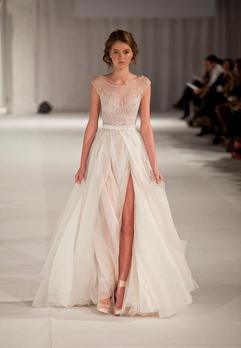 a chic cap sleeve embroidered sparkling bodice wedding dress with a layered skirt and a front slit