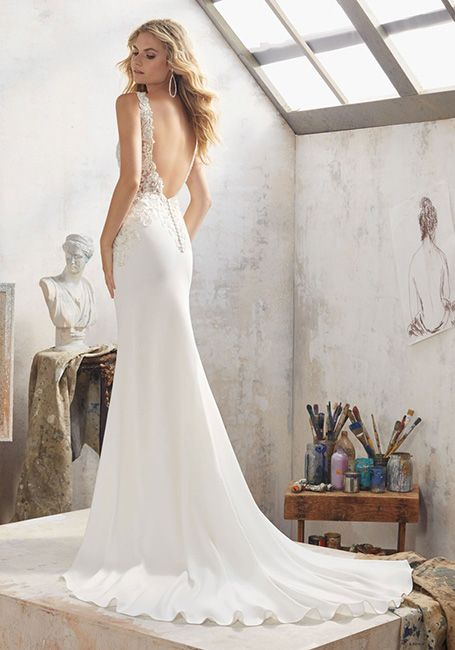 a feminine mermaid wedding dress with a lace beaded bodice, a cutout back and a small train