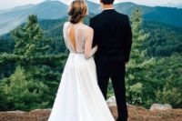 22 a gorgeous lace wedding dress with a sheer bodice and sleeves and a cutout back