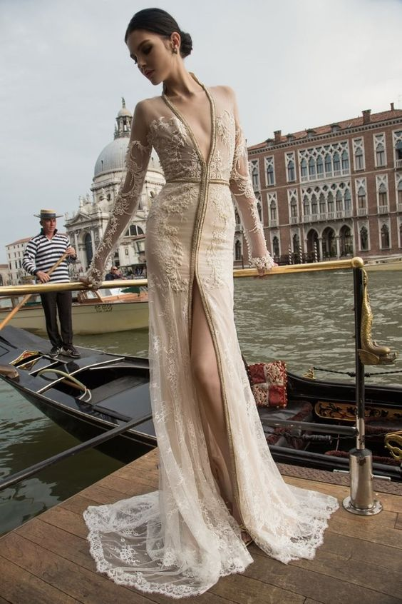 ivory wedding dress with a plunging neckline, a front slit and illusion lace sleeves