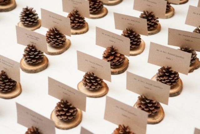 pinecone place card holders on thin wood slices are very easy to make and won't cost a thing