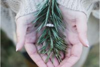 22 show off your engagement ring on a fir branch