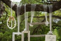23 a fun photo booth with various frames hanging from the tree will make the pics cuter