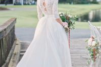 23 a high neckline A-line wedding dress with a lace top, half sleeves and a full skirt, keyholes on the back