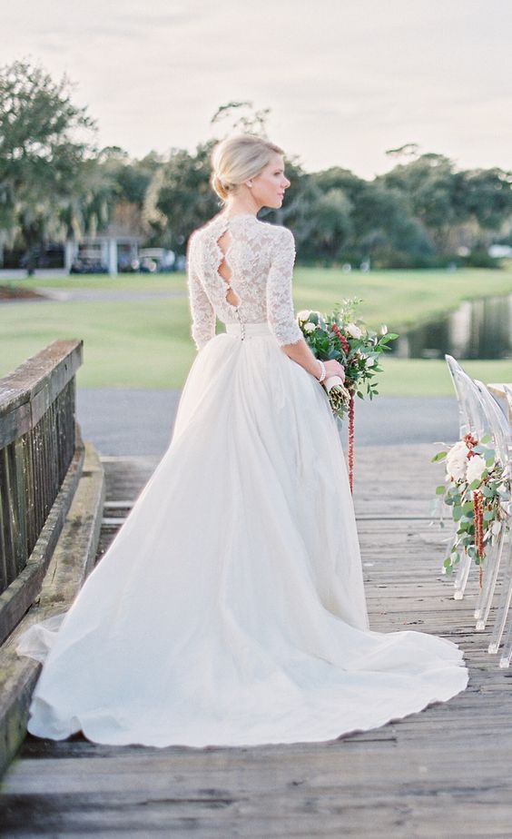 a high neckline A-line wedding dress with a lace top, half sleeves and a full skirt, keyholes on the back