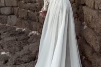 24 a sleek wedding dress with long sleeves, an open back and a train for a modern bride