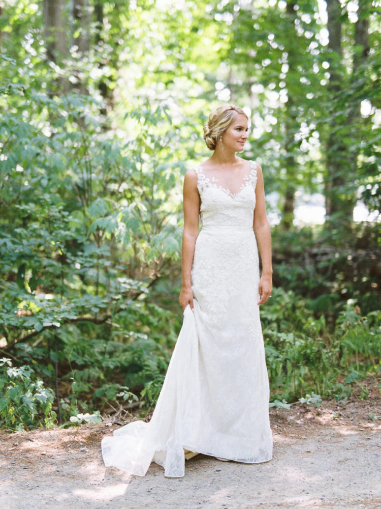 a sleeveless illusion neckline wedding dress with lace appliques, a lace skirt and a train