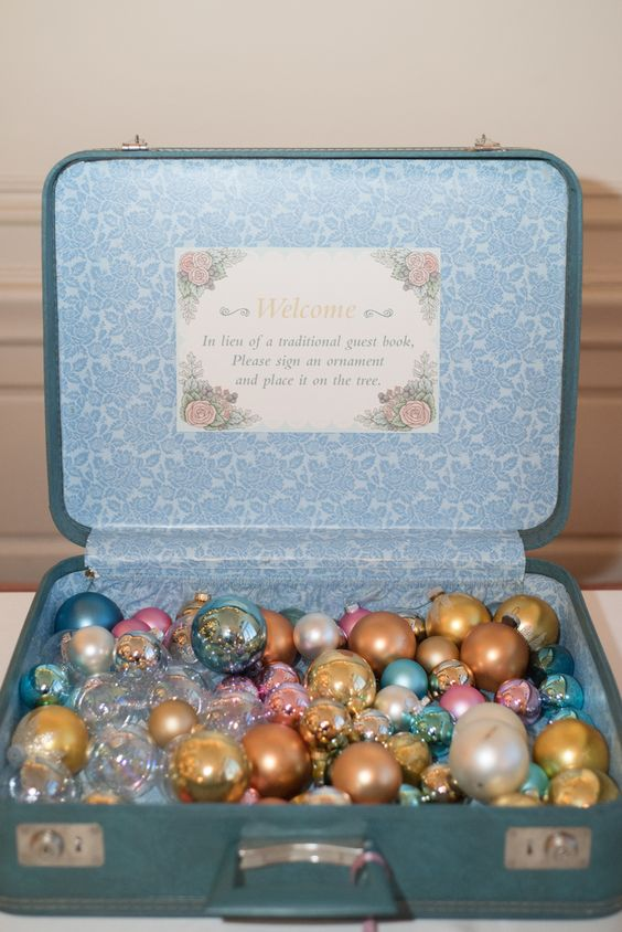 a vintage suitcase with Christmas ornament for sign in is a cool alternative to a guest book
