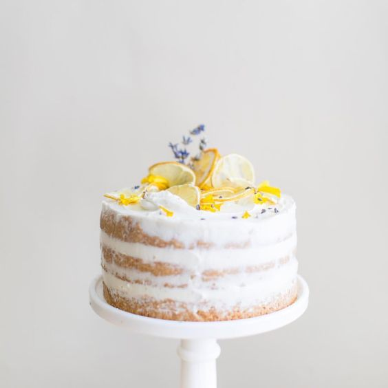lavender and lemon curd chiffon cake, decorated with dried lemon slices, fresh lavender, and edible flower petals