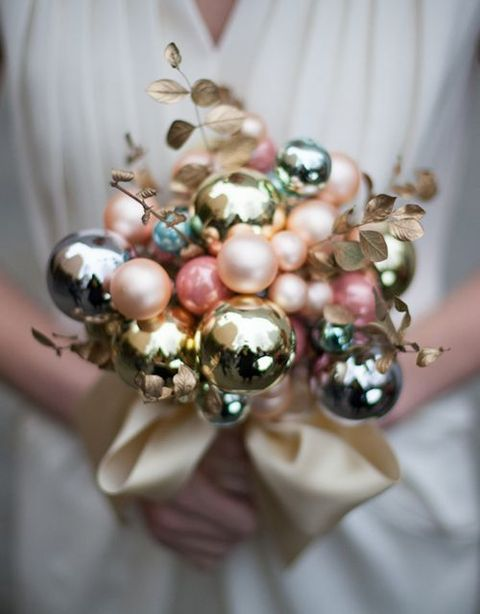 a chic shiny pastel Christmas ornament wedidng bouquet with faux foliage looks unusual