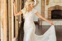 25 a sheath lace wedding dress with short sleeves and a train