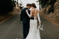 25 amazing lace wedding dress with a chapel train, an open back and long sleeves
