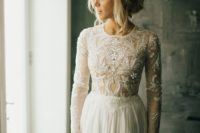 25 an illusion embroidered and embellished bodice and sleeves looks refined and sexy