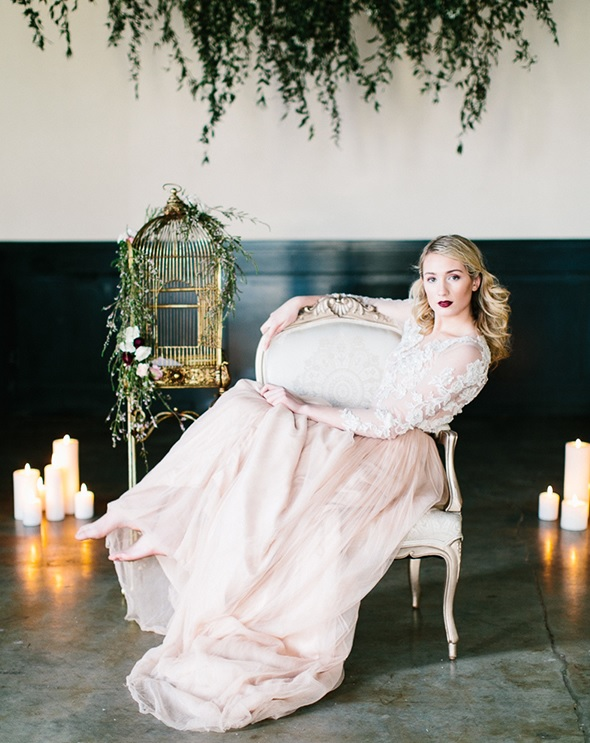 a pink wedding dress with a lace applique bodice and sleeves and a layered skirt