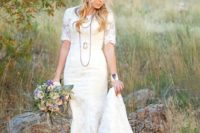 26 a sheath scoop neckline lace applique wedding dress with short sleeves and a train can be accessorized with layered necklaces