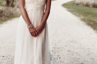 26 sweetheart neckline wedding dress with a heavily embellished bodice and a sweep train