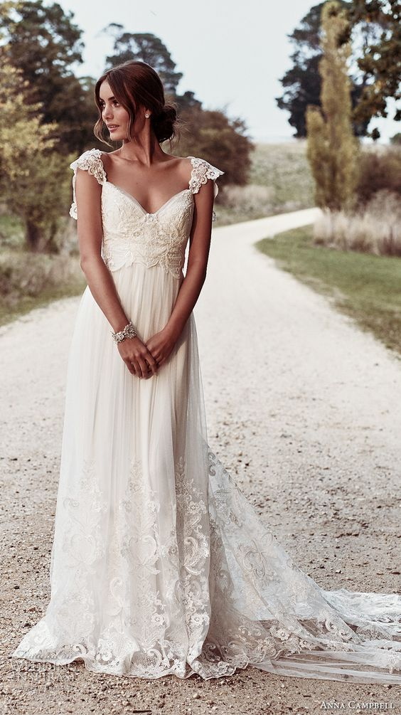 sweetheart neckline wedding dress with a heavily embellished bodice and a sweep train