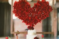 27 a frame with chicken wire and a heart applique to accentuate your cake table