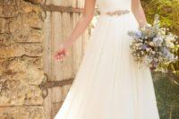 27 a sleek A-line bateau neckline wedding dress with cap sleeves and an embellished sash