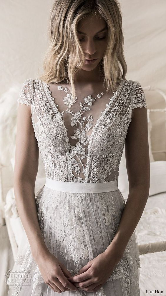 an illusion plunging neckline with floral lace appliques looks very sexy though decent