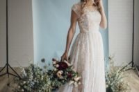 28 a textural A-line lace wedding dress with short sleeves and a scoop neckline