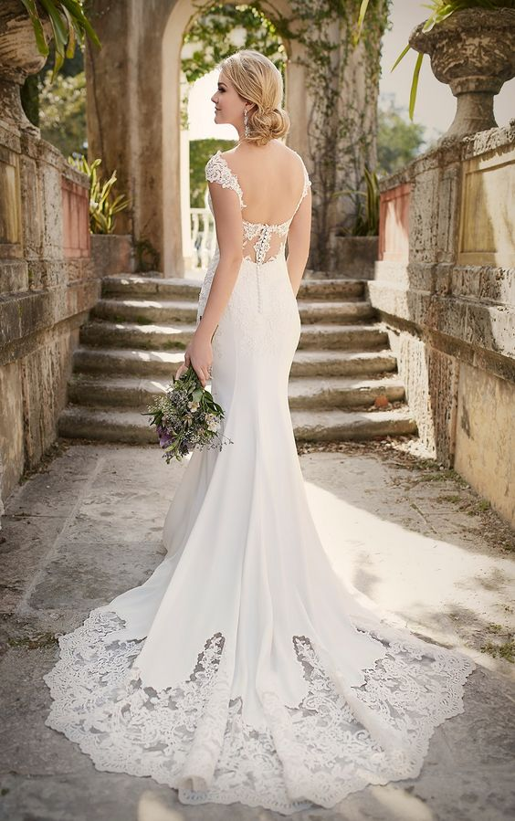 pretty lace cap sleeves, lace back detailing and a U cut, and a scalloped lace cathedral train
