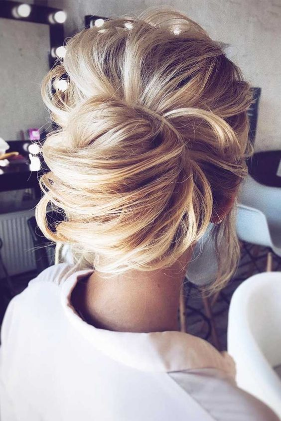 picture of messy chignon hairstyle with a voluminous top. Black Bedroom Furniture Sets. Home Design Ideas