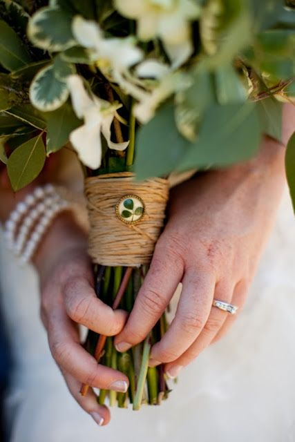 twine and a vintage button with leaves for a rustic greenery bouquet