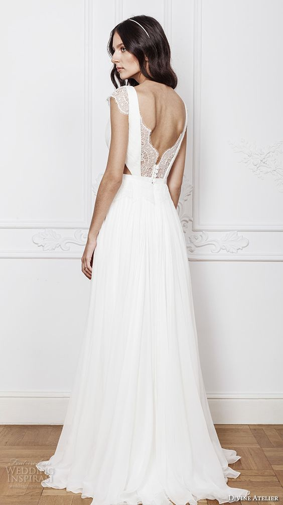 wedding dress with cap sleeves, a cutout back with a lace and buttons detail