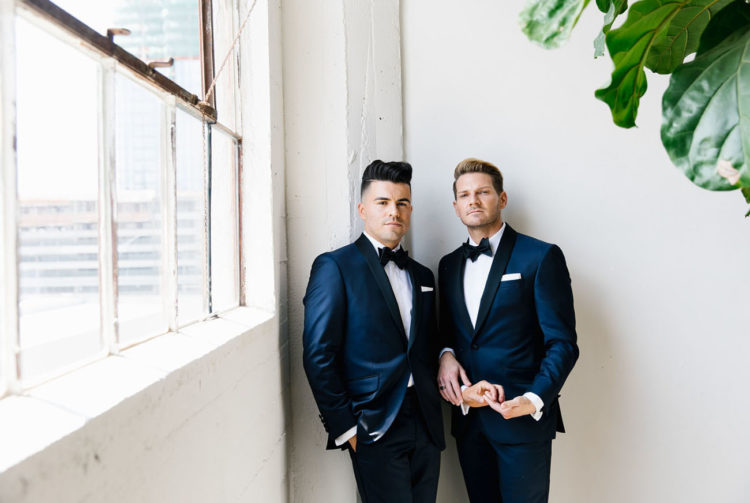 These dapper grooms got married in an industrial venue and turned it into a greenhouse