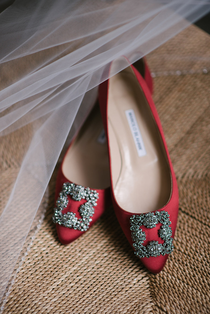 The bride was wearing red Manolo Blahnik shoes