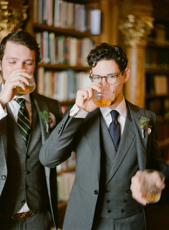 The groom was wearign a grey three-piece suit and a navy tie, his groomsmen prefered grey tweed to feel warm