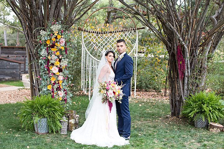 The trees were decorated with blooms and there was an embroidery hoop macrame decoration for the ceremony space