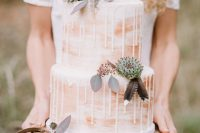02 The wedding cake was a peach-colored watercolor one, with drizzling, succulents and feathers on top