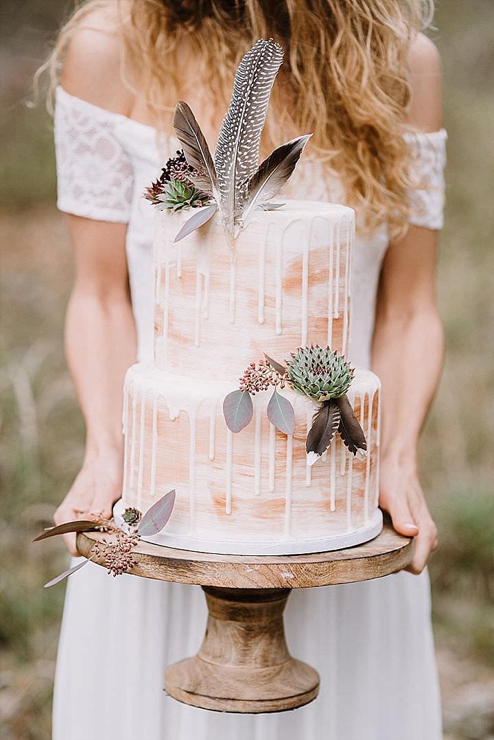 The wedding cake was a peach-colored watercolor one, with drizzling, succulents and feathers on top