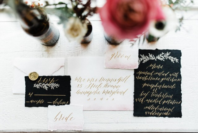 The wedding stationery was done in black and blush, with a raw edge and gold calligraphy