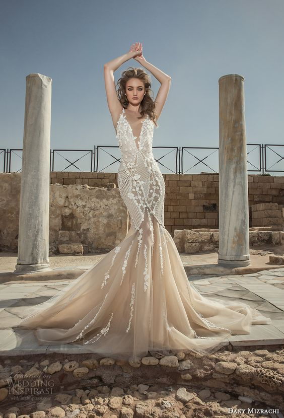 a fantastic mermaid wedding dress with an illusion plunging neckline, lace appliques and a train