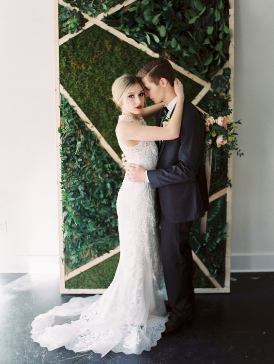 a geometric moss and greenery wedding backdrop looks ideal for a modern affair