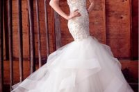 02 a strapless heavily embellished wedding dress with a ruffled tail looks very chic, refined and sexy