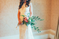 03 Her dress was a lace sleeveless one with an illusion neckline and back and a train