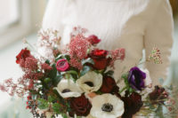 03 The bride was wearing a bold bouquet with marsala, purple and white touches and berries