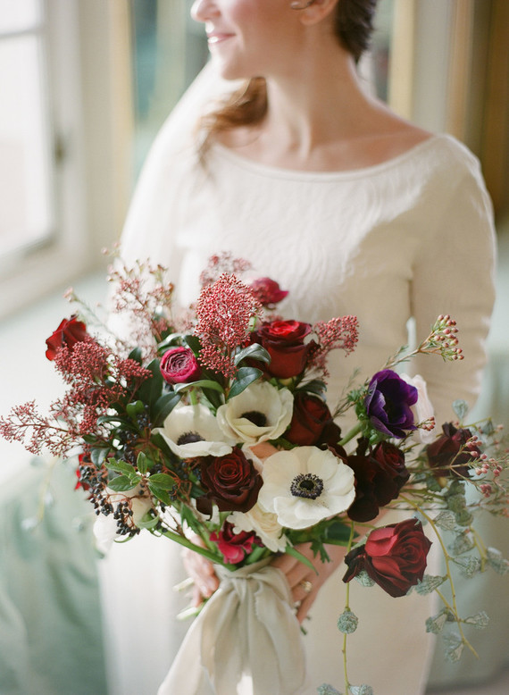 The bride was wearing a bold bouquet with marsala, purple and white touches and berries