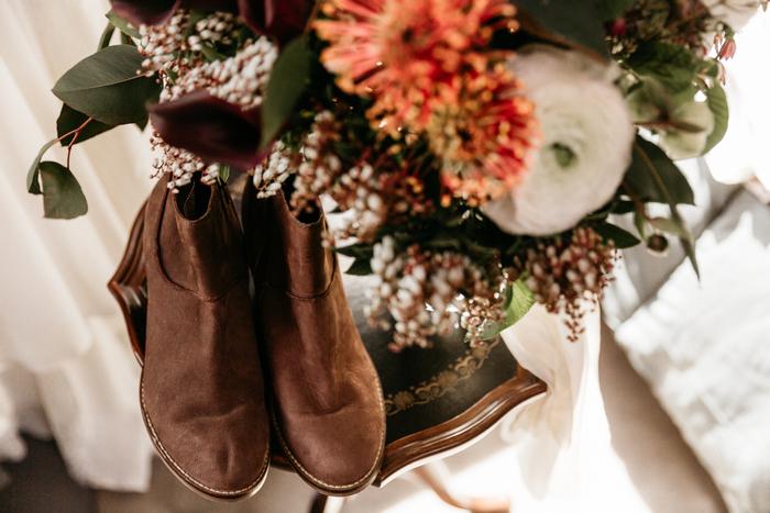 The bride was wearing custom made brown suede booties