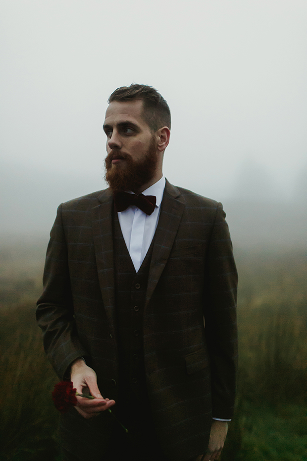 The groom was wearing a checked brown tweed suit with a waistcoat and a marsala velvet bow tie