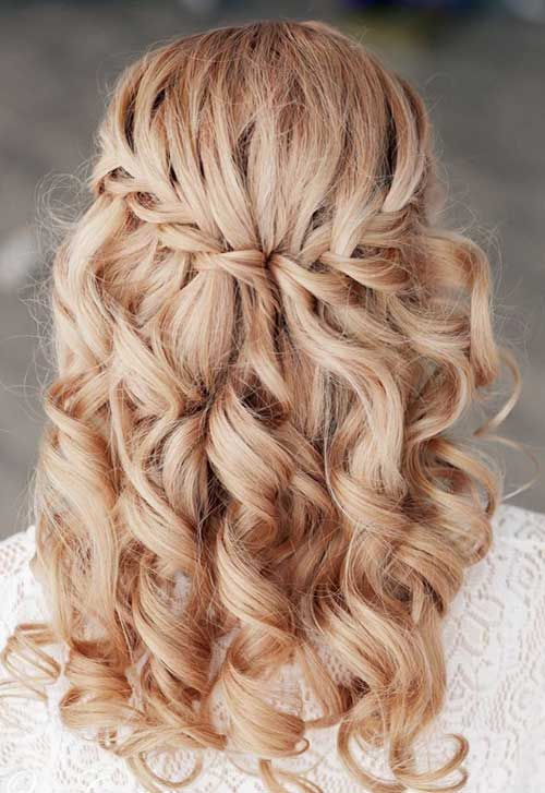 a braided half updo with curls looks cute, girlish and very glam