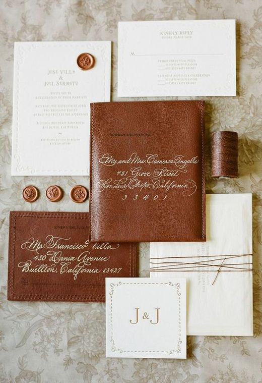 a gorgeous brown leather and white paper wedding invitation suite with calligraphy and letter pressing